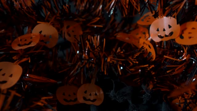 Halloween pumpkins hanging decoration string movement in dark background