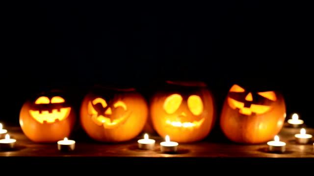 Halloween pumpkins on black background video