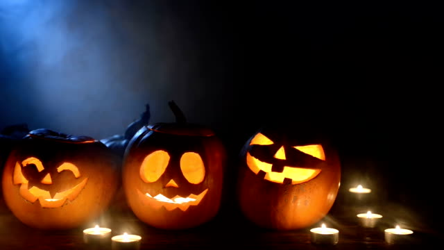 Halloween pumpkins on smoky background video