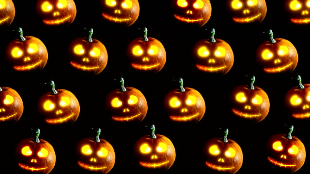 Halloween pumpkins Group of Halloween Jack o Lanterns on dark background. 4k video. ghost icon stock videos & royalty-free footage