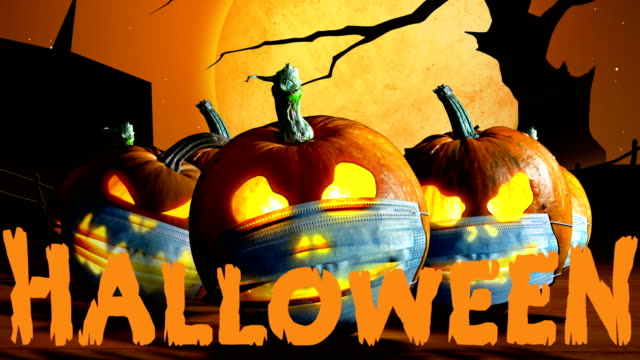 Halloween pumpkins Halloween pumpkins in a protective medical face masks on  cemetery background.  Lettering Halloween. Second wave of coronavirus infection in autumn. New normal concept. Jack o lantern and Covid-19 concept. halloween covid stock videos & royalty-free footage