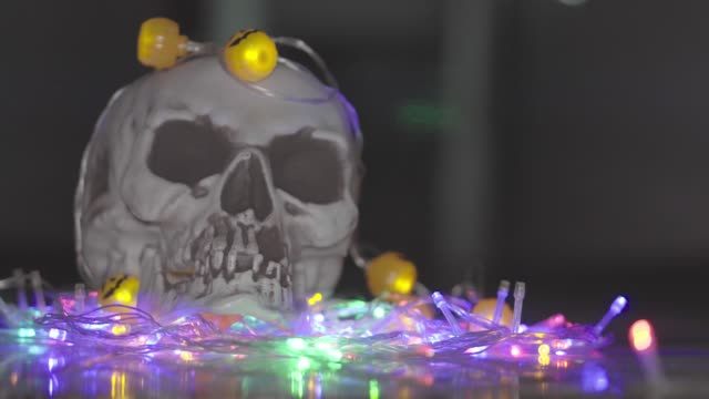 Halloween with a skull in a room with beautiful lights and lights.