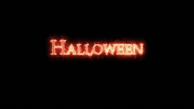 halloween written with fire. loop - call center стоковые видео и кадры b-roll