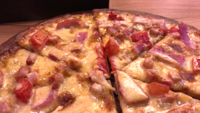 Ham and bacon with extra cheese pizza , Bangkok , Thialand Enjoy eating pizza in the good pizzaria in Bangkok 2016. onion ring stock videos & royalty-free footage