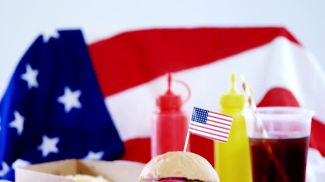 Hamburger and cold drink arranged on tablecloth video