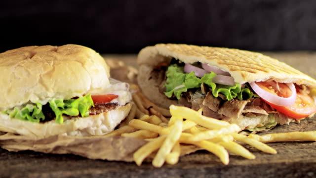 slo-mo-ds-hamburger, pommes und döner - döner stock-videos und b-roll-filmmaterial