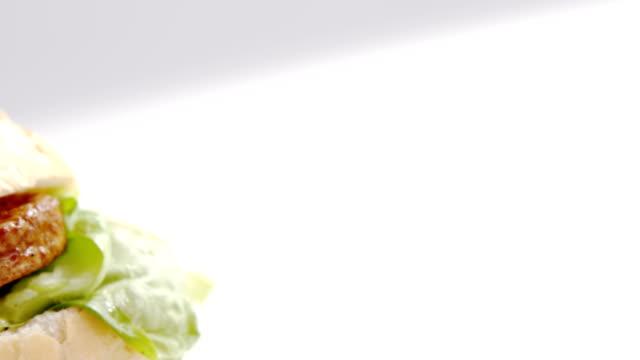 Hamburger on white background Close-up of hamburger on white background sesame stock videos & royalty-free footage