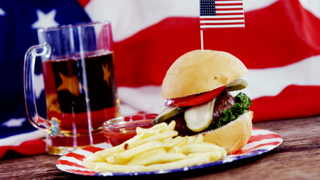Hamburger on wooden table with 4th july theme video