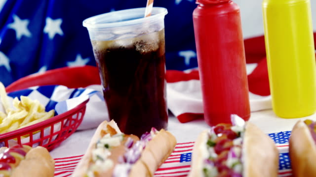 Hamburgers and cold drink served on American flag video
