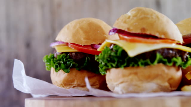 Hamburgers on wooden board video