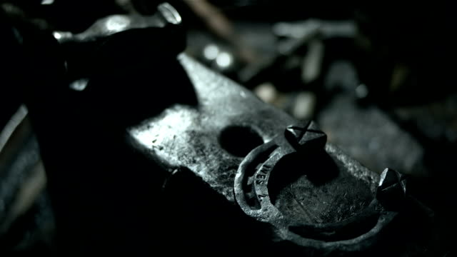 HD: Hammer And Horseshoe Laying On An Anvil HD1080p: CLOSE-UP shot of a hammer and finished horseshoe laying on an anvil. wrought iron stock videos & royalty-free footage