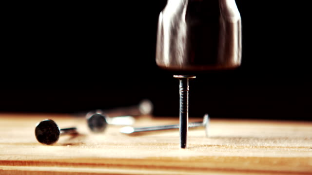 Hammer hammering nail into wood video