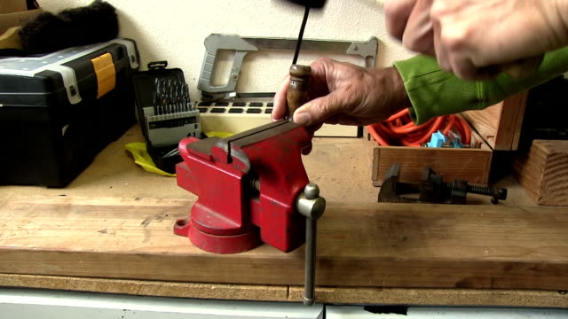 Hammering a marker punch into a red vice video