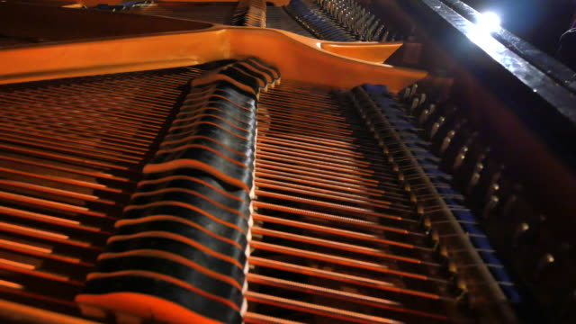 Hammers on Strings, Grand Piano Close Up, Dolly Out Shot, Cinematic Lighting video