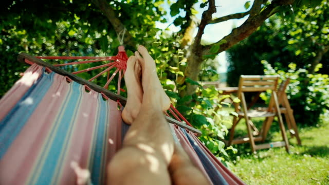 Hammock relaxing point of view Hammock relaxing point of view human foot stock videos & royalty-free footage