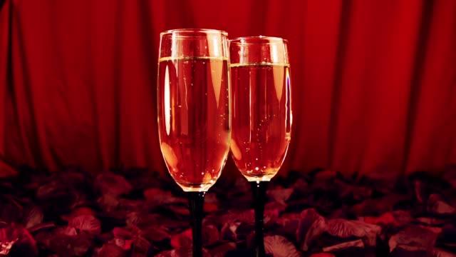 Сhampagne glasses on celebration table. Valentine's Day.