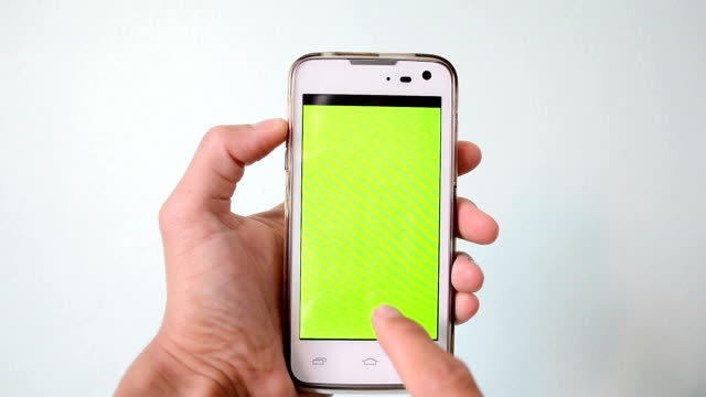 hand action on green screen of smart phone video