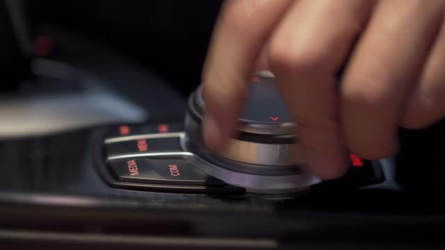 Hand adjust car control panel wheel in modern car