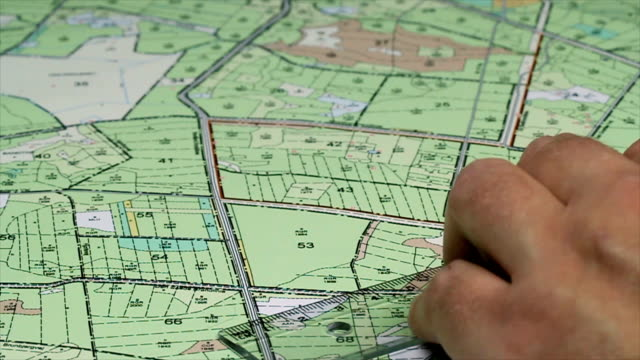 Hand and ruler on detailed map (1080p) video