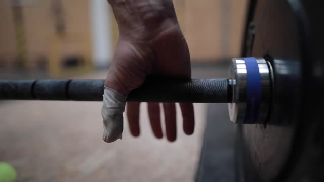 Hand Catches Weight In Gym Close Up Of Hand Catches Weight In Gym gripping stock videos & royalty-free footage