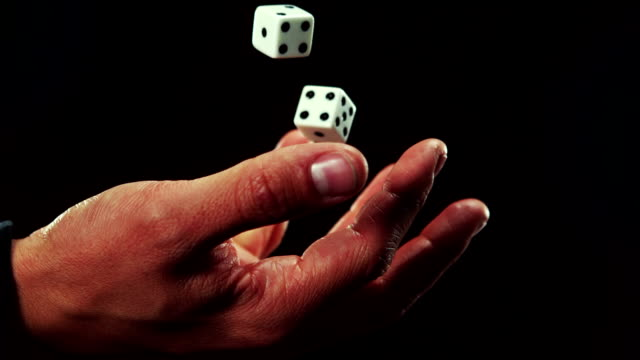 Hand catching a dice video