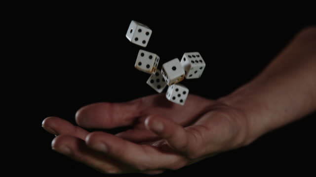 SLO MO Hand catching gambling dices Super slow motion close up shot of an unrecognizable person's hand catching playing dices. desire stock videos & royalty-free footage
