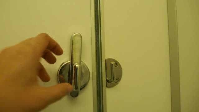 Hand close the toilet door by tweaking the door knob video