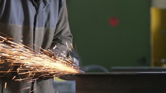 hand close up of man in workshop grinding iron spark fire hot steel with power tool and protective gear hand close up of a man in workshop grinding iron spark fire hot steel with power tool and protective gear power tool stock videos & royalty-free footage