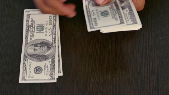 Hand counts bank money. video