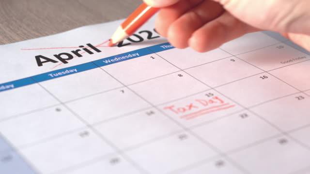 Hand cross off Tax day calendar