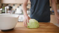 istock hand cut white cabbage on wooden cutting board 1340294329