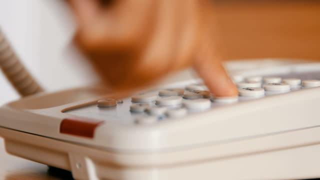 Hand dialing number on telephone Hand dialing number on telephone landline phone stock videos & royalty-free footage