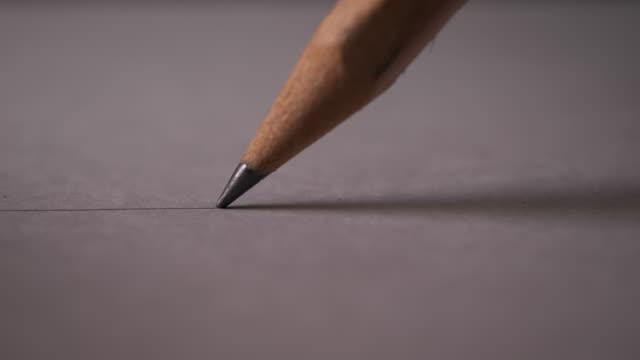 hand ritning en platt linje med en svart penna - blyertspenna bildbanksvideor och videomaterial från bakom kulisserna