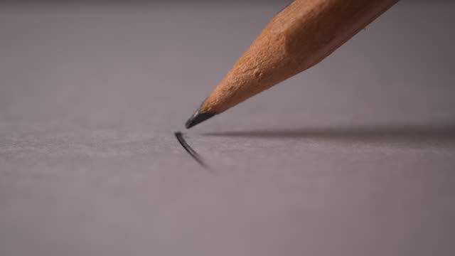 Hand drawing a flat line with a black pencil video