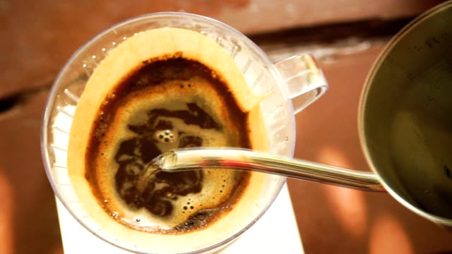 Hand drip coffee, Barista pouring water on coffee ground with filter video