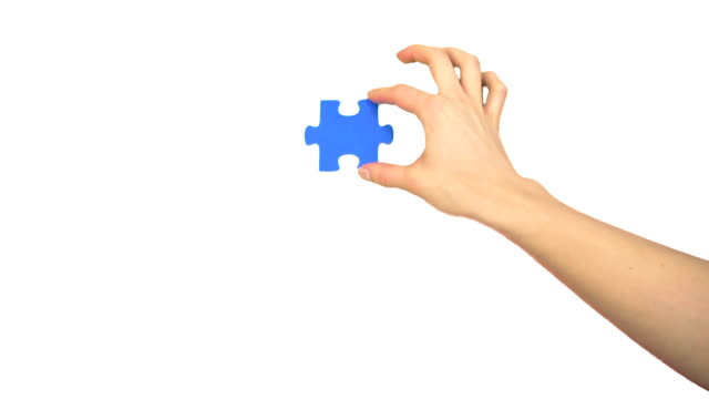Hand fitting piece of puzzle video