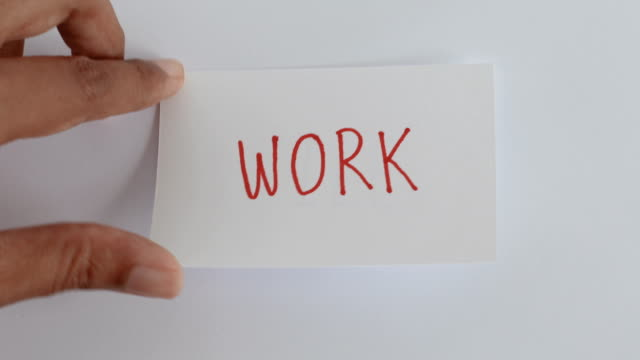 hand flip the paper card of  work  to life word , motivation for work life balance concept - balance video stock e b–roll