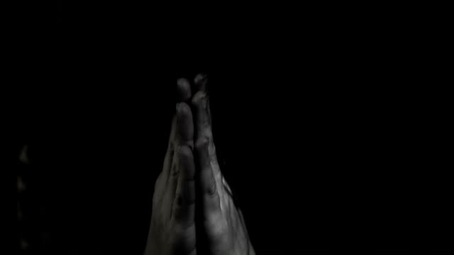 Hand gestures. Woman praying to god. Black and White video