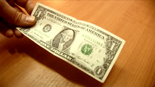 hand gives dollar to another man - dollar bill stock videos & royalty-free footage