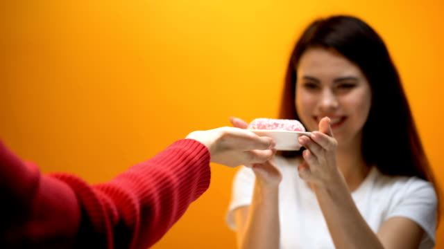 hand giving donut to girl, society accustoms generation to sweet food, sugar - gluten free stock videos and b-roll footage
