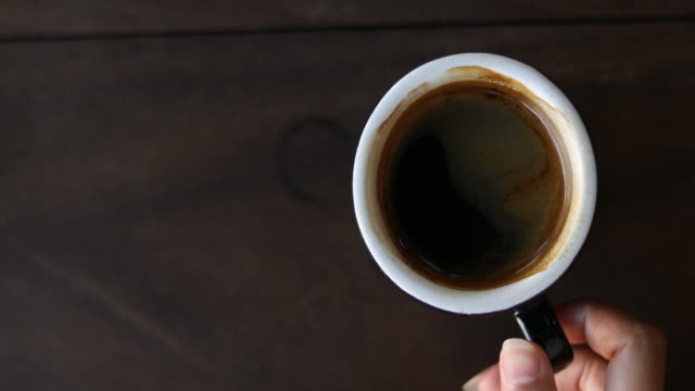hand grab a cup of black coffee – Video