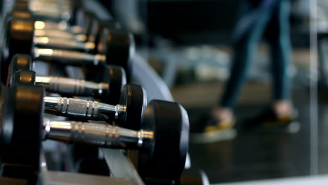 hand grab dumbbell in fitness video
