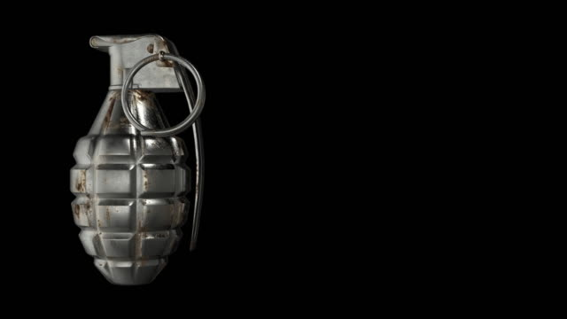 Hand grenade rotating against a black background - seamless looping
