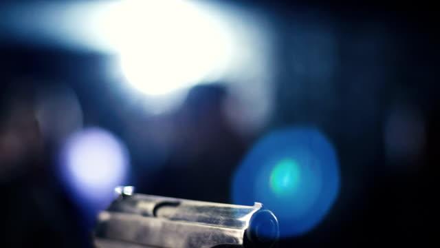 hand gun being pointed - огнестрельное оружие стоковые видео и кадры b-roll