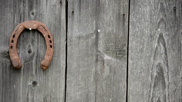 hand hang horse shoe - horseshoe stock videos & royalty-free footage
