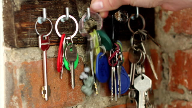 hand hangs on a hook a bunch of keys - key ring stock videos & royalty-free footage