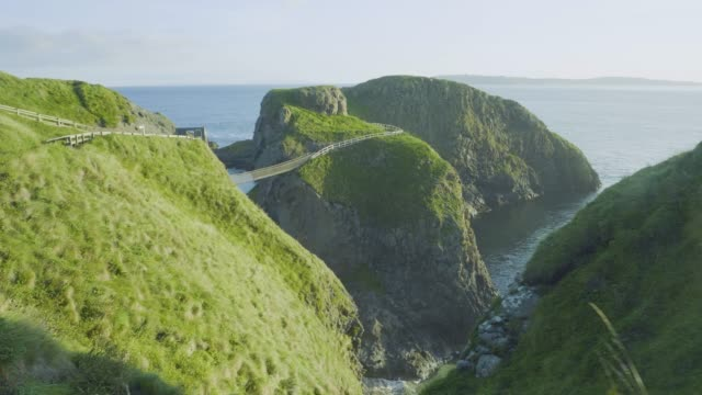 hand hold shoot view of  Carrick-a-Rede Rope Bridge  in Northern Ireland hand hold shoot view of  Carrick-a-Rede Rope Bridge  in Northern Ireland b roll stock videos & royalty-free footage