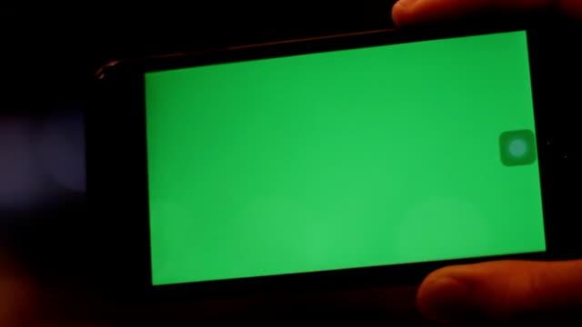hand hold smartphone green screen video