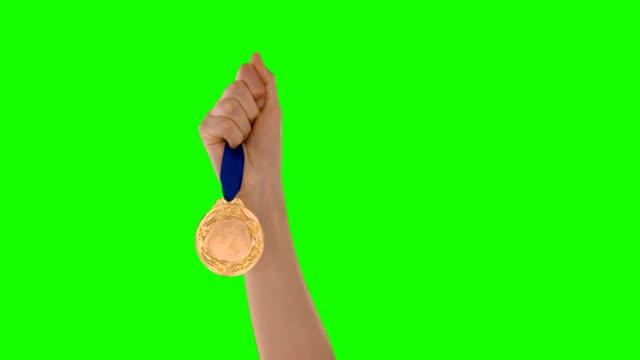 ハンド保持、メダル - メダル点の映像素材/bロール