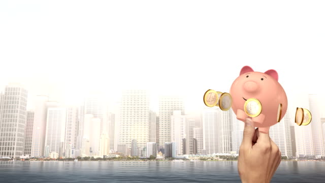 Hand Holding A Piggy Bank With Euro Coins video